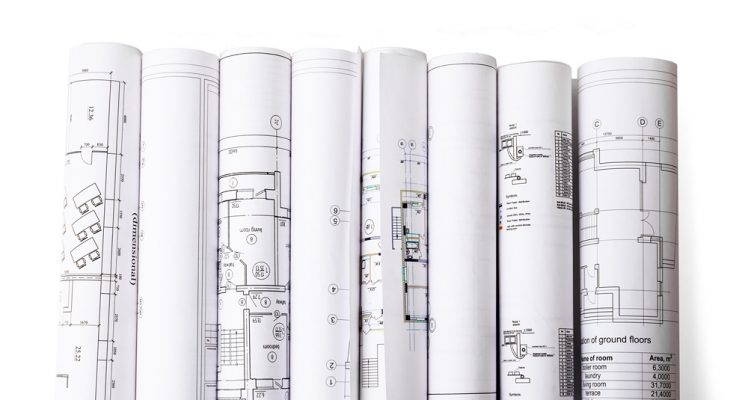 Set of architectural drafting service blueprint rolls isolated on white background